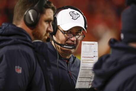 Houston Texans head coach Bill O'Brien talks to offensive coordinator Tim Kelly during the fourth quarter of an AFC divisional playoff game at Arrowhead Stadium on Sunday, Jan. 12, 2020, in Kansas City, Mo.