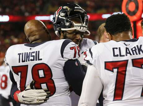 Houston Texans offensive tackles Laremy Tunsil (78) and Roderick Johnson (63) embrace as time runs out in the fourth quarter of an AFC divisional playoff game against the Kansas City Chiefs at Arrowhead Stadium on Sunday, Jan. 12, 2020, in Kansas City, Mo.
