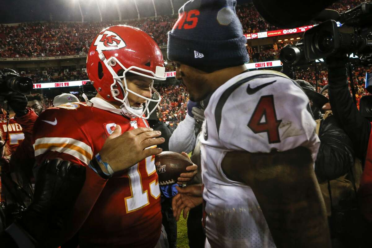 Kansas City Chiefs quarterback Patrick Mahomes (15) and Houston Texans quarterback Deshaun Watson (4) embrace after the Chiefs 51-31 win over the Texans in an AFC divisional playoff game at Arrowhead Stadium on Sunday, Jan. 12, 2020, in Kansas City, Mo.