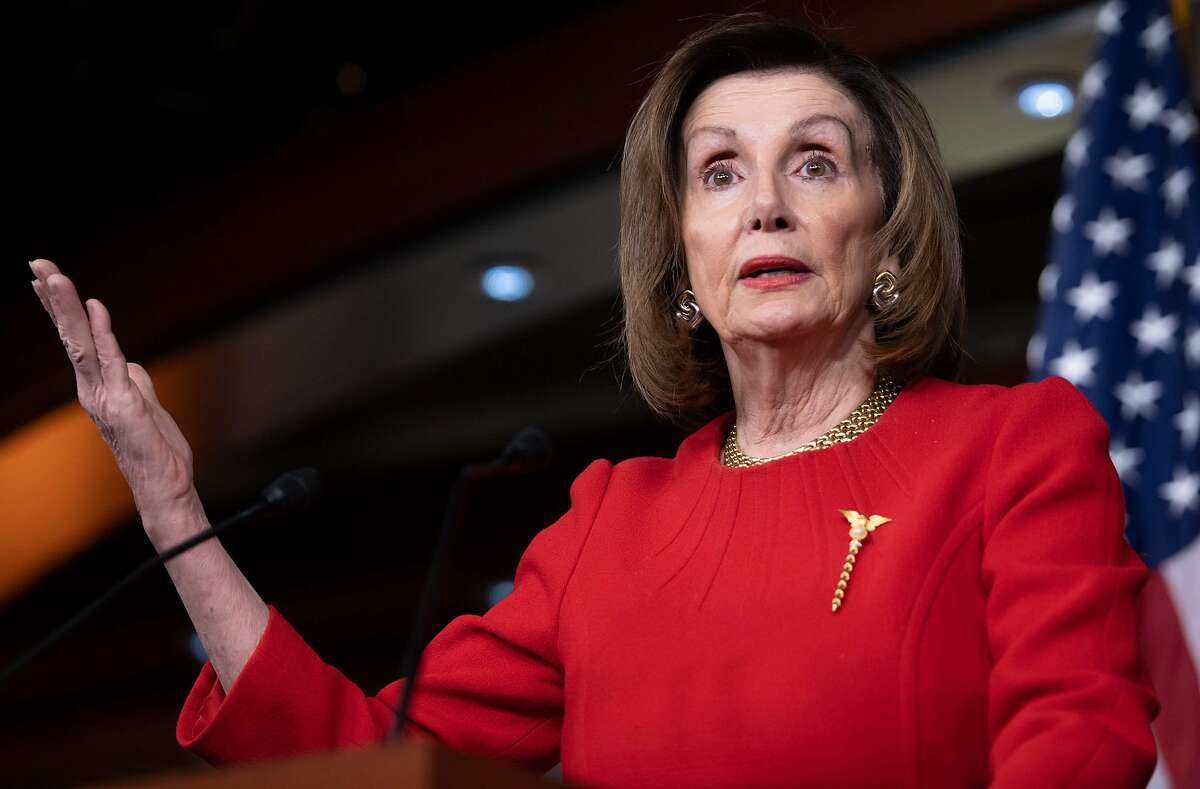 """(FILES) In this file photo taken on December 19, 2019 Speaker of the House Nancy Pelosi holds a press conference on Capitol Hill in Washington, DC. - Top US Democrat Nancy Pelosi said on January 12, 2020 that she believes the impeachment hearings against Donald Trump produced """"enough testimony to remove him from office"""" when the case moves to the Senate. Speaker Pelosi will meet with the House Democratic caucus early Tuesday to prepare for the formal vote required to send the two articles of impeachment passed by the House on to the Senate, as early as this week. (Photo by SAUL LOEB / AFP) (Photo by SAUL LOEB/AFP via Getty Images)"""