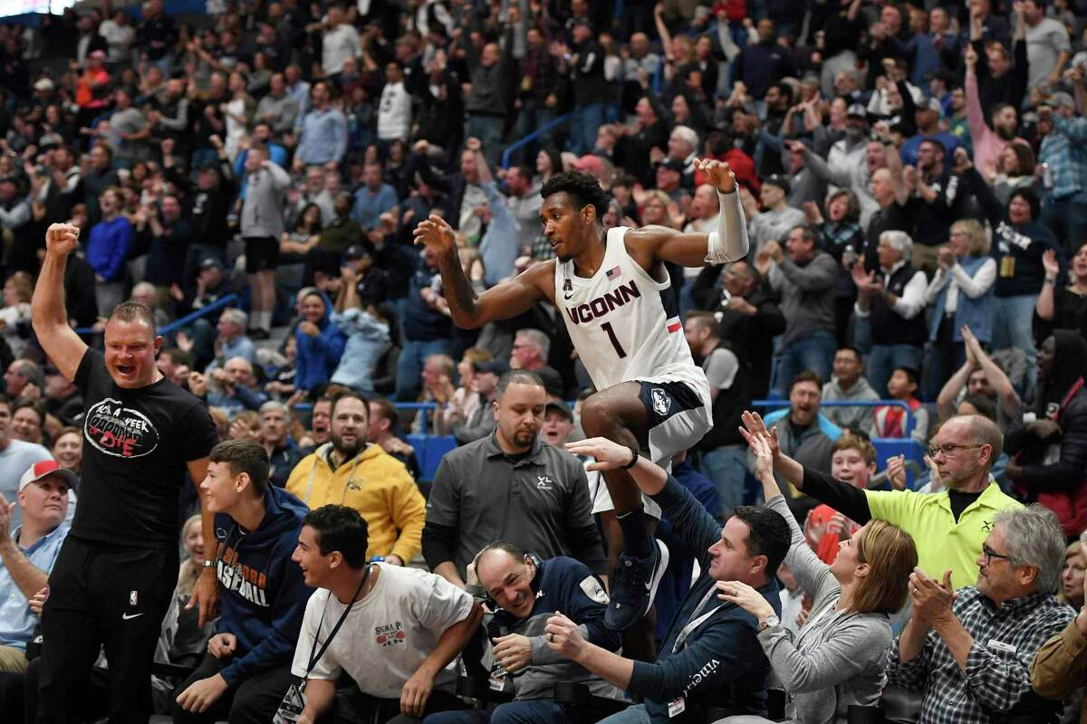 UConn's Christian Vital (1) leaps back onto the court after falling out of play in the first half against Wichita St. on Sunday in Hartford.