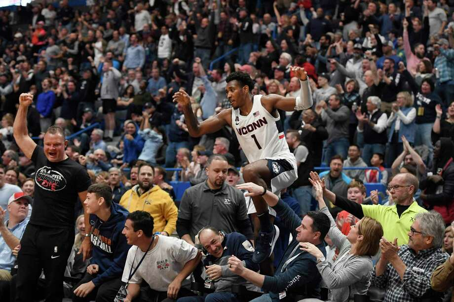 UConn's Christian Vital (1) leaps back onto the court after falling out of play in the first half against Wichita St. on Sunday in Hartford. Photo: Jessica Hill / Associated Press / Copyright 2019 The Associated Press. All rights reserved.