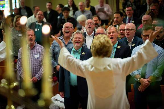 Worshippers sing during a Blessing of Unions service at Bering Church.