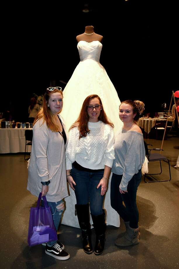 The Warner Theatre held its annual Bridal Event on Sunday, Jan. 12. Rachel Boyle, bride-to-be Kelsey Boland and Ashlee McLauhlin pose with a gown from Ida's Boutique in Torrington. Photo: Lara Green-Kazlauskas / Hearst Connecticut Media /