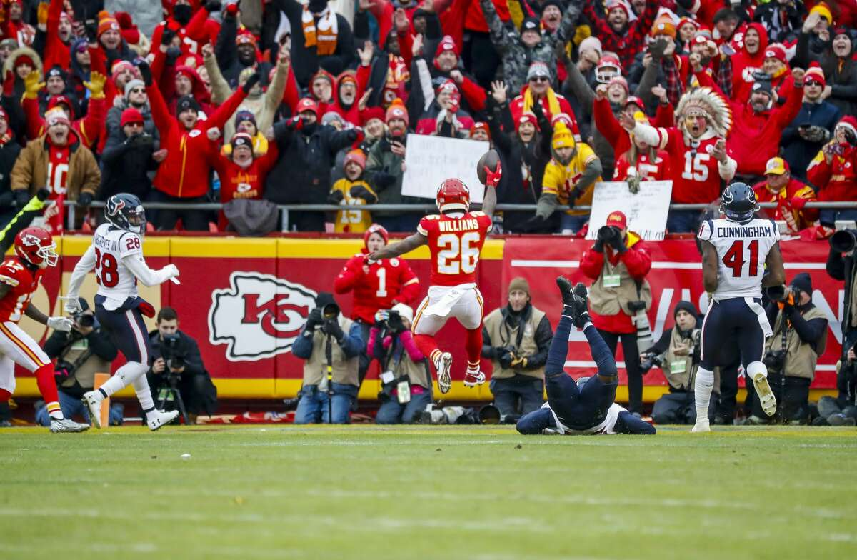 Kansas City Chiefs running back Damien Williams (26) runs into the end zone on 17 yard pass for the first of six unanswered touchdowns for the Chiefs during an AFC divisional playoff game at Arrowhead Stadium on Sunday, Jan. 12, 2020, in Kansas City, Mo.
