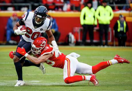 Houston Texans strong safety Justin Reid (20) is tackled short of the first down by Kansas City Chiefs defensive back Daniel Sorensen (49) on a fake punt during the second quarter of an AFC divisional playoff game at Arrowhead Stadium on Sunday, Jan. 12, 2020, in Kansas City, Mo.