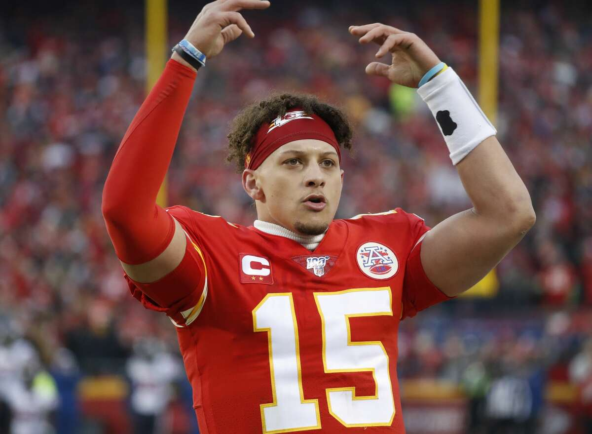 Kansas City Chiefs quarterback Patrick Mahomes (15) tries to get the crowd fired up in the second quarter of an AFC divisional playoff game at Arrowhead Stadium on Sunday, Jan. 12, 2020, in Kansas City, Mo.
