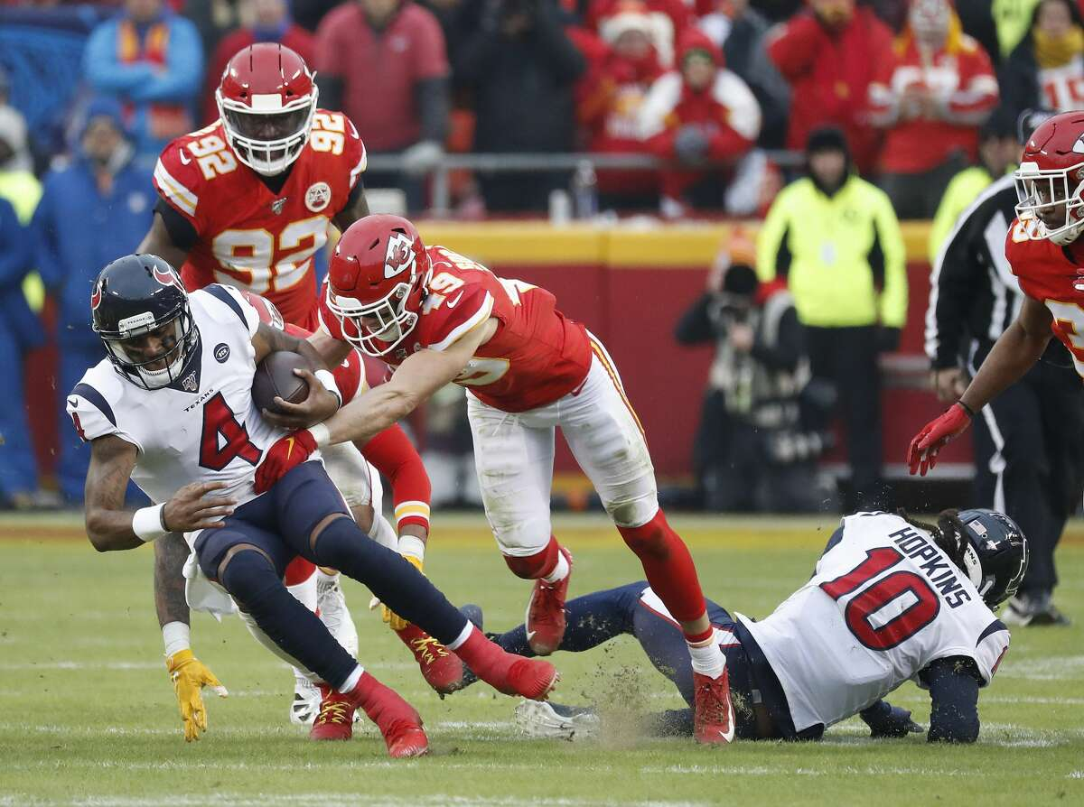 Houston Texans quarterback Deshaun Watson (4) is brought down by Kansas City Chiefs defensive back Daniel Sorensen (49) in the second quarter of an AFC divisional playoff game at Arrowhead Stadium on Sunday, Jan. 12, 2020, in Kansas City, Mo.