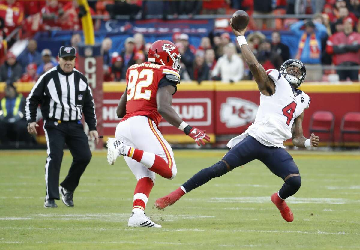 Houston Texans quarterback Deshaun Watson (4) tries to make an awkward throw against Kansas City Chiefs defensive end Tanoh Kpassagnon (92) in the second quarter of an AFC divisional playoff game at Arrowhead Stadium on Sunday, Jan. 12, 2020, in Kansas City, Mo.