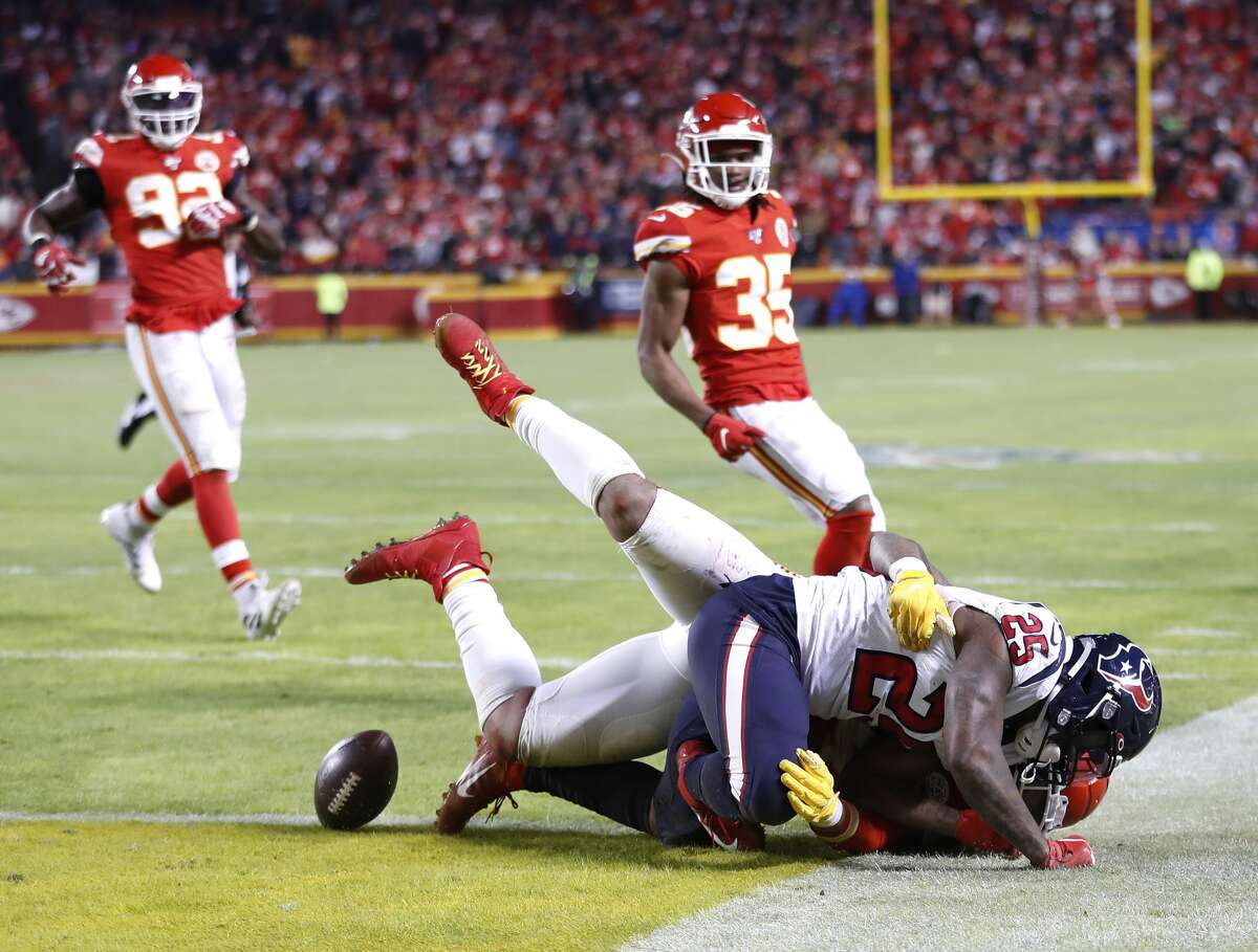 Houston Texans running back Duke Johnson (25) gets brought down near the goal line by a Kansas City Chiefs defender in the fourth quarter of an AFC divisional playoff game at Arrowhead Stadium on Sunday, Jan. 12, 2020, in Kansas City, Mo.
