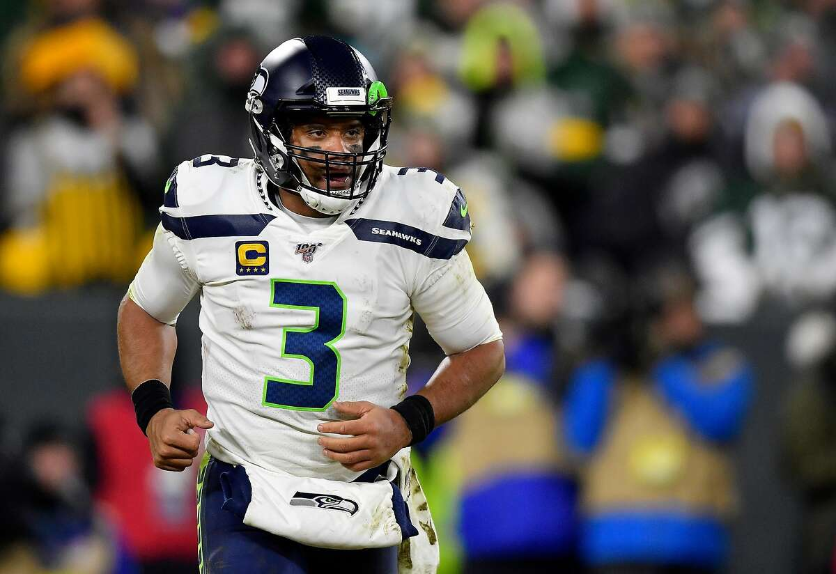 GREEN BAY, WISCONSIN - JANUARY 12: Russell Wilson #3 of the Seattle Seahawks looks on against the Green Bay Packers in the third quarter of the NFC Divisional Playoff game at Lambeau Field on January 12, 2020 in Green Bay, Wisconsin. (Photo by Quinn Harris/Getty Images)