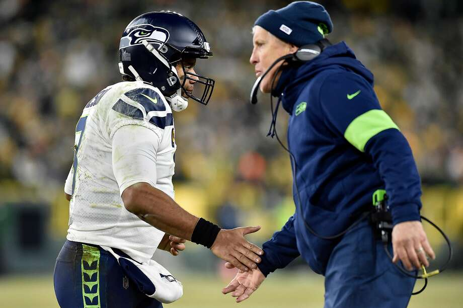 GREEN BAY, WISCONSIN - JANUARY 12: Quarterback Russell Wilson #3 of the Seattle Seahawks talks with head coach Pete Carroll as they take on the Green Bay Packers in the NFC Divisional Playoff game at Lambeau Field on January 12, 2020 in Green Bay, Wisconsin. (Photo by Quinn Harris/Getty Images) Photo: Quinn Harris, Getty Images