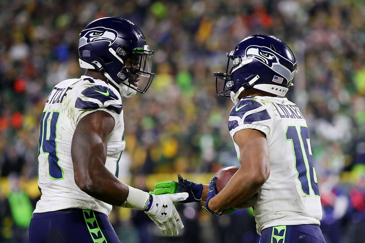 GREEN BAY, WISCONSIN - JANUARY 12: Tyler Lockett #16 of the Seattle Seahawks celebrates with DK Metcalf #14 after scoring a touchdown during the third quarter against the Green Bay Packers in the NFC Divisional Playoff game at Lambeau Field on January 12, 2020 in Green Bay, Wisconsin. (Photo by Gregory Shamus/Getty Images)