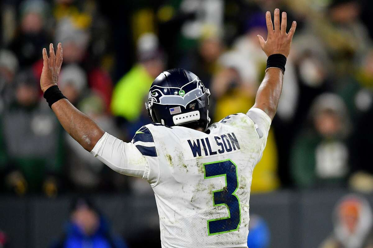 GREEN BAY, WISCONSIN - JANUARY 12: Russell Wilson #3 of the Seattle Seahawks reacts as they take on the Green Bay Packers in the third quarter of the NFC Divisional Playoff game at Lambeau Field on January 12, 2020 in Green Bay, Wisconsin. (Photo by Quinn Harris/Getty Images)