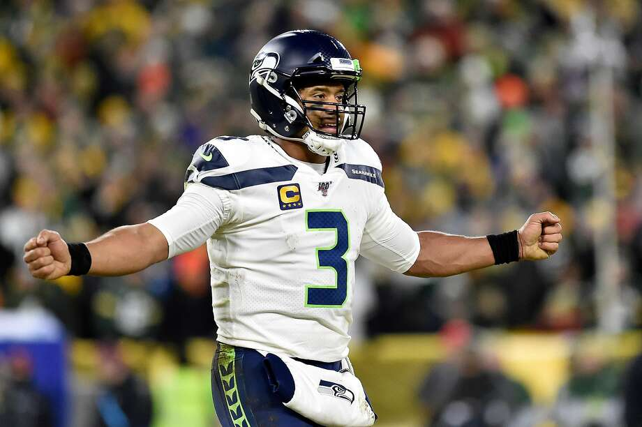 GREEN BAY, WISCONSIN - JANUARY 12: Russell Wilson #3 of the Seattle Seahawks reacts as they take on the Green Bay Packers in the third quarter of the NFC Divisional Playoff game at Lambeau Field on January 12, 2020 in Green Bay, Wisconsin. (Photo by Quinn Harris/Getty Images) Photo: Quinn Harris, Getty Images
