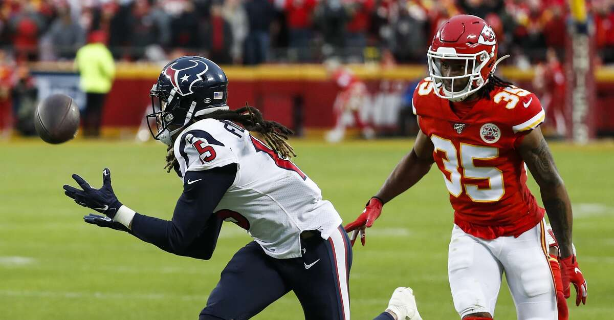 Houston Texans wide receiver Will Fuller (15) beats Kansas City Chiefs cornerback Charvarius Ward (35) for a first down during the fourth quarter of an AFC divisional playoff game at Arrowhead Stadium on Sunday, Jan. 12, 2020, in Kansas City, Mo.