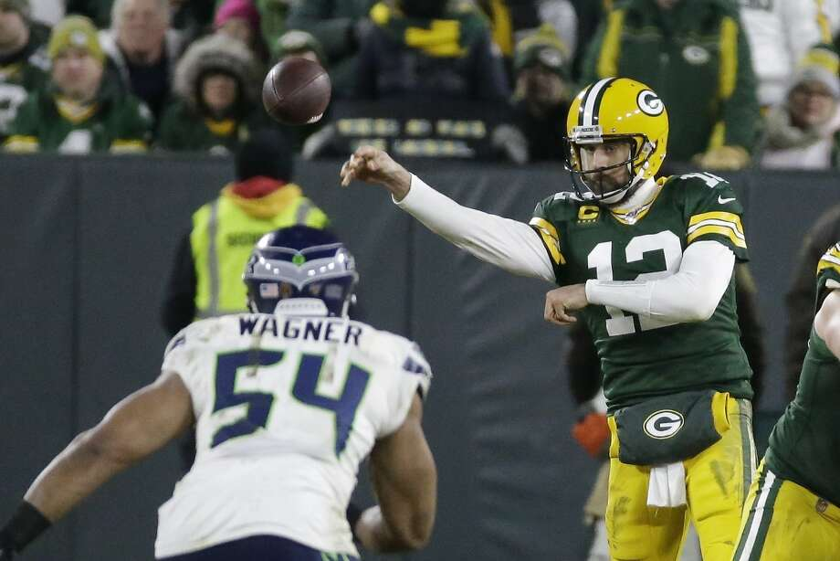 Green Bay Packers' Aaron Rodgers throws during the second half of an NFL divisional playoff football game against the Seattle Seahawks Sunday, Jan. 12, 2020, in Green Bay, Wis. (AP Photo/Mike Roemer) Photo: Mike Roemer, Associated Press