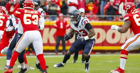 Houston Texans running back Carlos Hyde (23) runs during the first quarter of an AFC divisional playoff game at Arrowhead Stadium on Sunday, Jan. 12, 2020, in Kansas City, Mo.