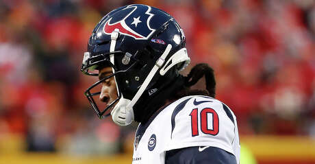 Houston Texans wide receiver DeAndre Hopkins (10) walks off the field holding his side during the fourth quarter of an AFC divisional playoff game against the Kansas City Chiefs at Arrowhead Stadium on Sunday, Jan. 12, 2020, in Kansas City, Mo.