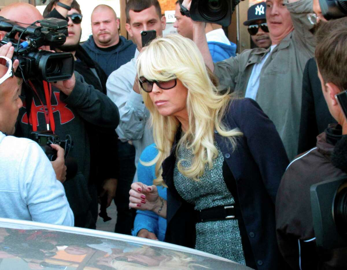 FILE - Dina Lohan leaves court in Hempstead, N.Y. in this Sept. 24, 2013 file photo after pleading not guilty to drunken driving charges. Actress Lindsay Lohan's mother is facing charges related to another drunken driving incident after authorities say she rear-ended a driver and then left the scene. Dina Lohan, who has a history of driving while intoxicated, was driving with a suspended license on Saturday evening Jan. 11, 2020 when she hit another driver near Merrick Mall in Long Island, authorities said. The driver called police and followed Lohan to her Long Island home when she didn't stop. (AP Photo/Frank Eltman, File)