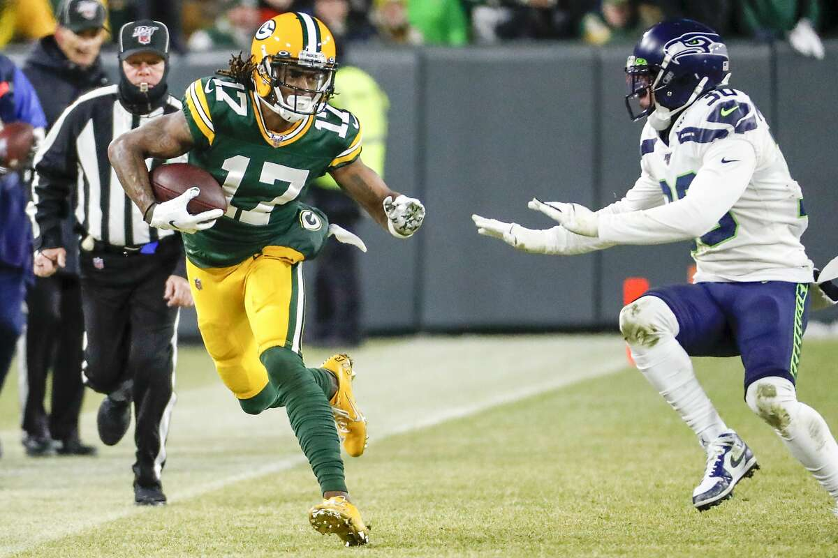 Green Bay Packers' Davante Adams runs after a catch during the first half of an NFL divisional playoff football game against the Seattle Seahawks Sunday, Jan. 12, 2020, in Green Bay, Wis. (AP Photo/Matt Ludtke)