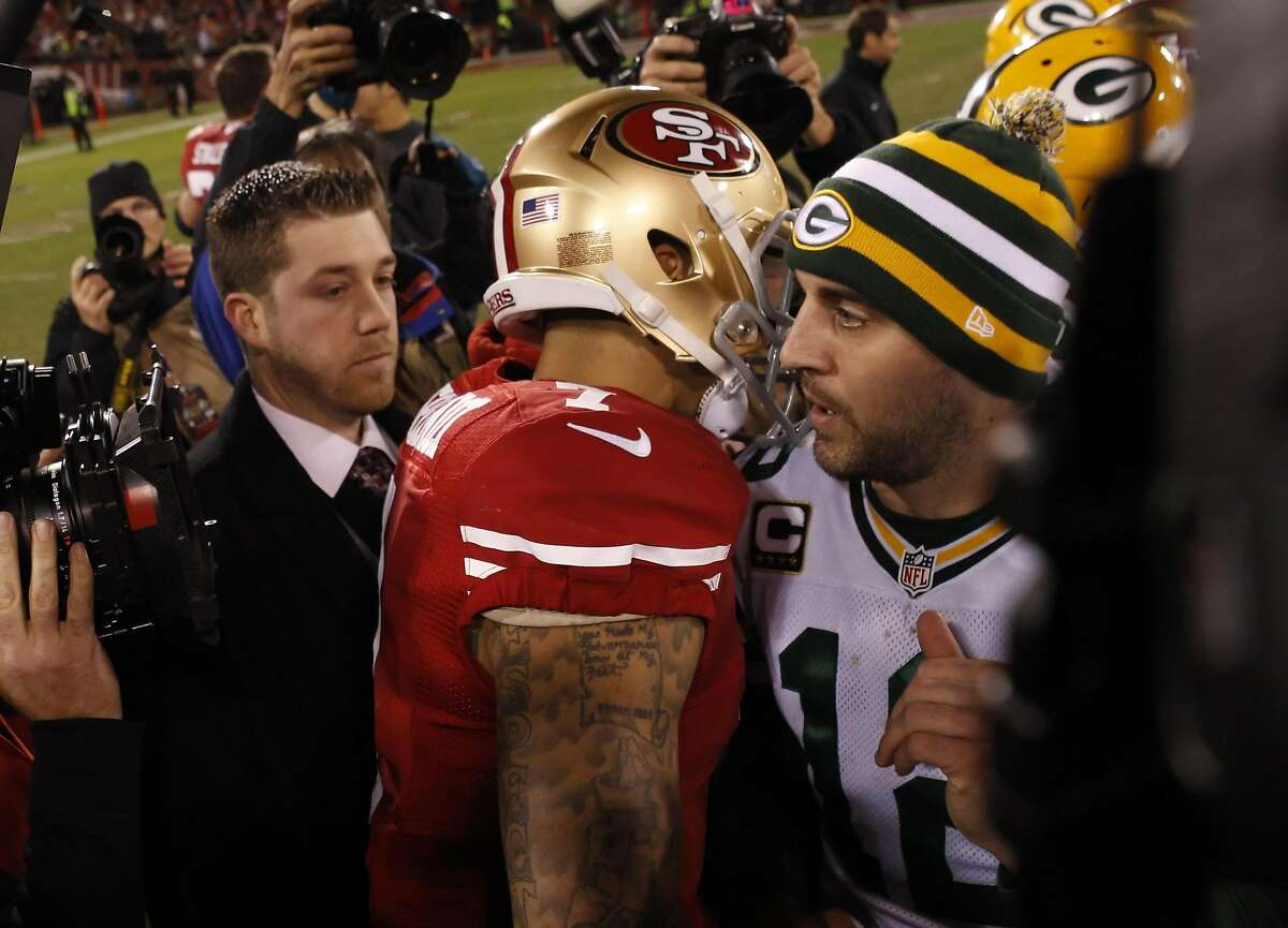 Aaron Rodgers right, hugs Colin Kaepernick, left, after the end of the game. The San Francisco 49ers played the Green Bay Packers in the NFC Divisional Playoff Game at Candlestick Park in San Francisco, Calif., on Saturday, January 12, 2013. The 49ers won the game 45-31 and advance to the NFC Championship game.