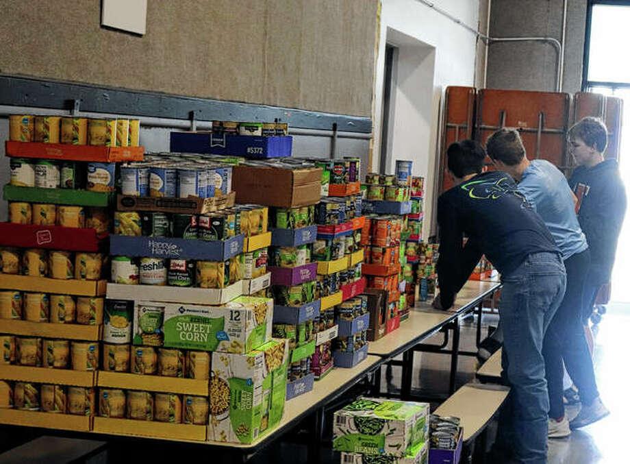 Franklin School District students organize food for the Lions Club Christmas Food Basket Drive. Photo: Photo Provided By Greg Tabeek