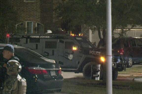 Houston police SWAT officers work the scene where a murder suspect was taken into custody in Fort Bend County on Monday, Jan. 13, 2020.
