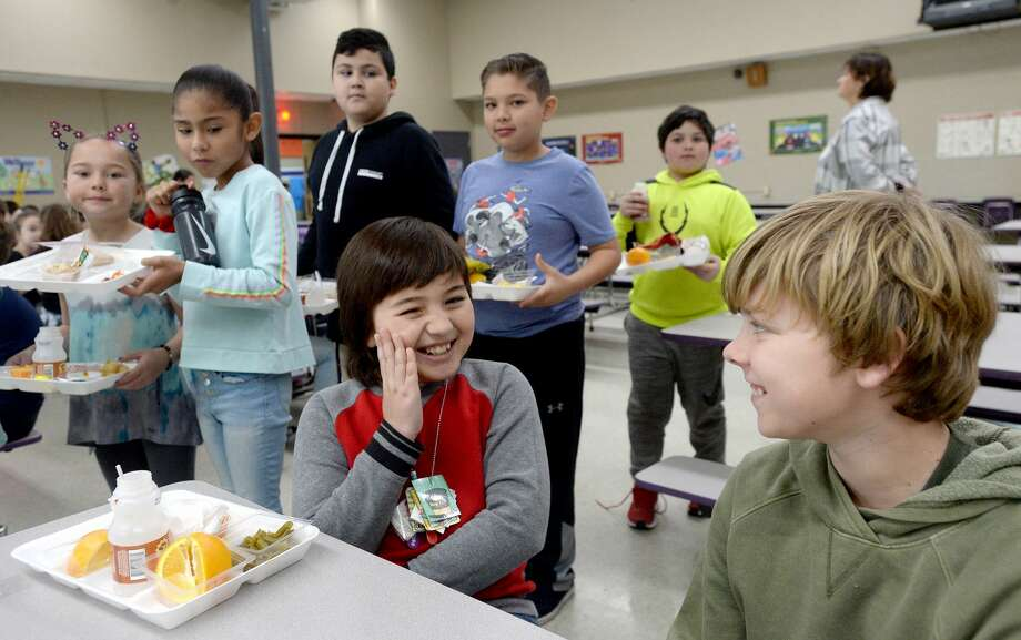 Earl Duhon jokes with fourth grade classmate and friend Griffin Laing during their lunch period at Port Neches Elementary School Wednesday. Earl started a birthday fundraising effort through Facebook, which was later matched by an anonymous donor. The total will cover lunch costs for students at the school throughout the remainder of the year. Photo taken Wednesday, January 8, 2020 Kim Brent/The Enterprise Photo: Kim Brent/The Enterprise