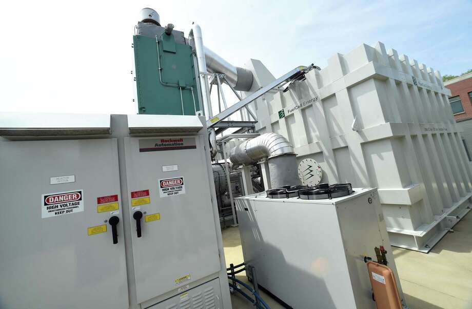 Fuel cells from FuelCell Energy behind Amity Regional High School in Woodbridge power a microgrid serving Amity Regional High School, Woodbridge Town Hall, the library, senior center, police headquarters, fire department and public works department. Photo: Arnold Gold / New Haven Register / New Haven Register