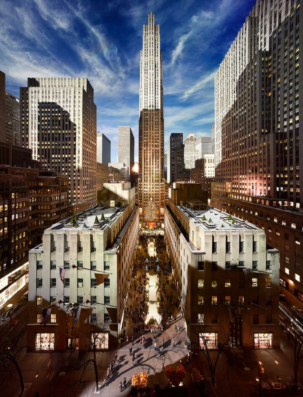 """Pictured is one of photographer Stephen Wilkes' photographs titled: """"Rockefeller Center Day to Night"""" that is on display at the Carriage Barn Arts Center in New Canaan. Wilkes visited his exhibit titled: """"Day to Night,"""" and signed copies of his recently published Taschen monograph on Sunday, January 26, 2020, at 3 p.m."""