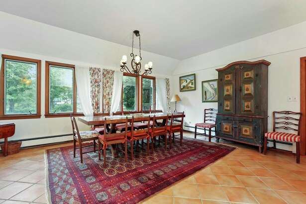 In the large formal dining room there is a fireplace, ceramic tile floor, a vaulted ceiling and French doors to the patio and yard.