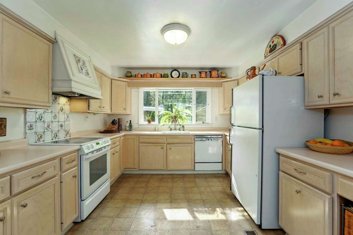 The kitchen has ample counter space and cabinets.