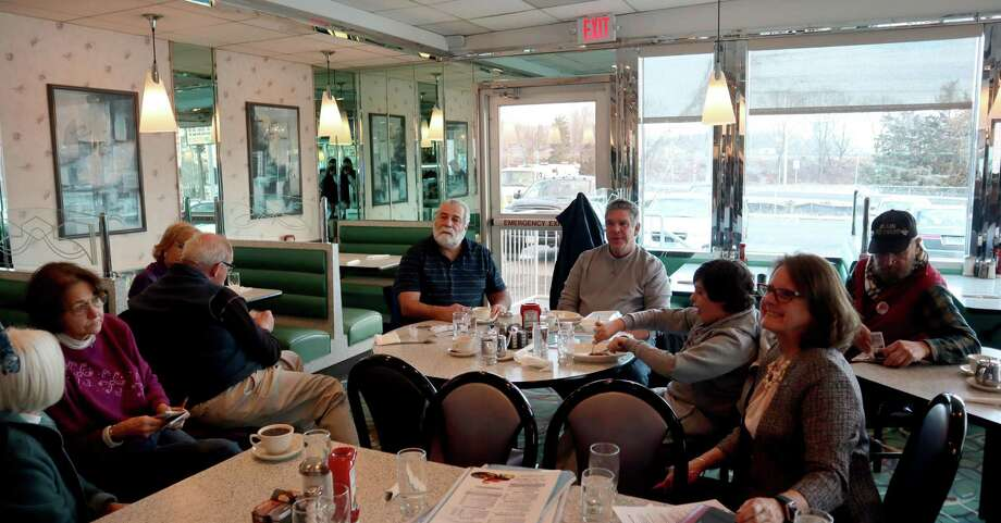 State Representatives Charles Ferraro (R-117) and Kathy Kennedy (R-119) met with local residents at the Athenian Diner in Milford on Wednesday to talk about the upcoming legislative session that begins Feb. 5. Photo: Contributed Photo