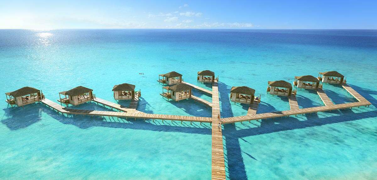 The island's Coco Beach Clubs offer floating cabanas and infinity edge pools.