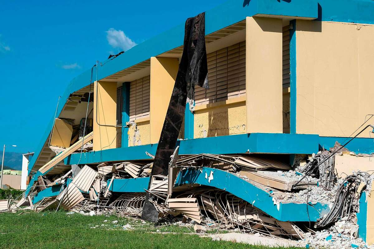 (FILES) In this file photo taken on January 11, 2020 The Agripina Seda school is seen destroyed after an earthquake hit the island in Guanica, Puerto Rico on January 11, 2020. - A 5.9 magnitude earthquake rocked Puerto Rico Saturday, the latest in a series of powerful tremors that have shaken the US territory in recent days, the US Geological Survey reported. The latest quake occurred at 8:54 am local time (1254 GMT) around 13 kilometers (eight miles) southeast of Guanica, a town on the island's southern Caribbean coastline that was hard hit by earlier quakes. (Photo by Ricardo ARDUENGO / AFP) (Photo by RICARDO ARDUENGO/AFP via Getty Images)