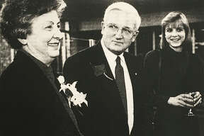 Jean Ott, left, Alan Ott, center, and their daugher Amy Ott Bushey, right, during Alan's retirement party at Chemical Bank in 1996. (Daily News file)