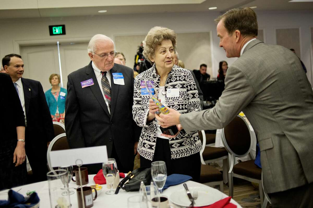 """Michigan Attorney General Bill Schuette, right, gives Jean, center, and Alan Ott, left, the Margaret Ann """"Ranny"""" Riecker Meritorious Service Award during the Midland County Republican Party's second annual Dave Camp Spring Breakfast on Monday, May 9, 2016 at the H Hotel. (Daily News file)"""