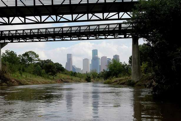 The Houston skyline as seen while canoeing down the Buffalo Bayou at Buffalo Bayou Park with Bayou City Adventures on a tour which originates at Lost Lake on Wednesday, Nov. 4, 2015, in Houston. ( Elizabeth Conley / Houston Chronicle )