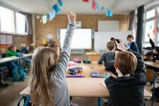 18 March 2019, Hamburg: ILLUSTRATION - Students of a fifth grade of a grammar school report in class. A Smartboard hangs in front of the classroom. Photo: Daniel Reinhardt/dpa (Photo by Daniel Reinhardt/picture alliance via Getty Images)