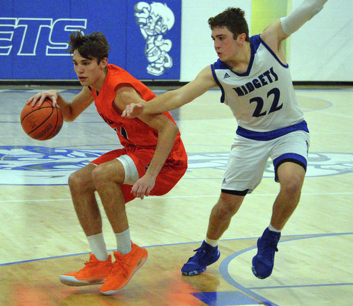 Edwardsville's Brennan Weller, left, tries to dribble past Freeburg's Griffin Range during Saturday's game. Freeburg is among five new non-conference opponents for the Tigers last season.