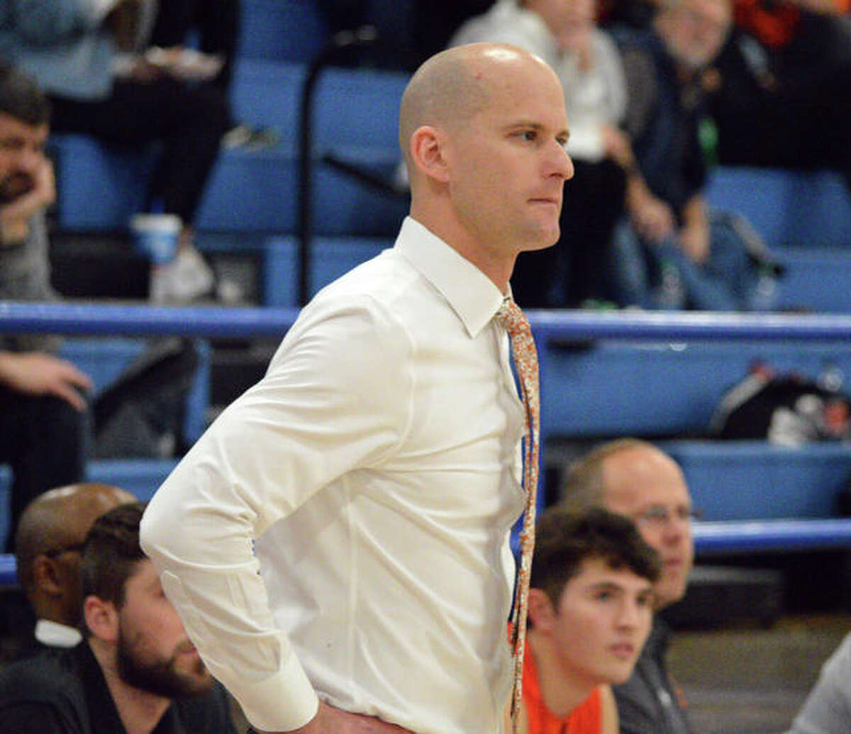 Edwardsville coach Dustin Battas watches the action during Saturday's non-conference game at Freeburg. Battas said EHS contacted about 70 schools in an attempt to fill seven openings on its non-conference schedule.
