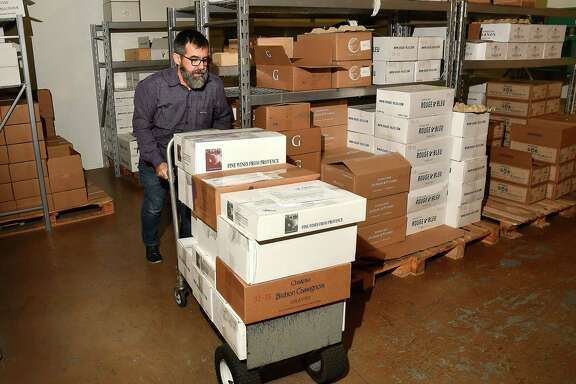 Owner Jean-Philippe Guy moves inventory at French Country Wines.