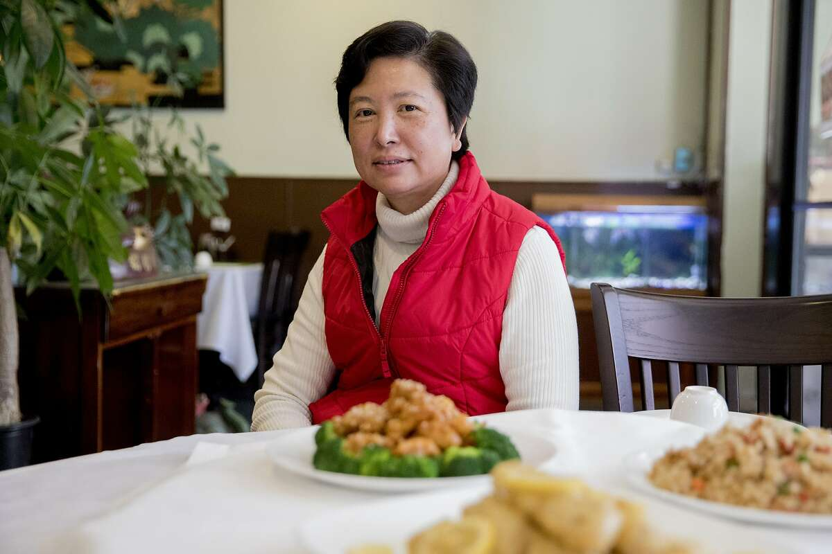 Owner Hui Lin poses for a portrait inside Nature Vegetarian Restaurant in Oakland, Calif. Tuesday, Dec. 31, 2019.