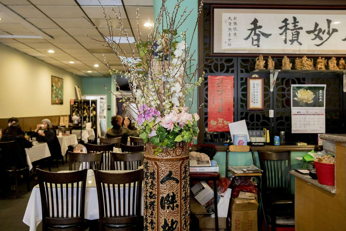 The entryway of Nature Vegetarian Restaurant is seen decorated in flowers and other Chinese decor in Oakland, Calif. Tuesday, Dec. 31, 2019.