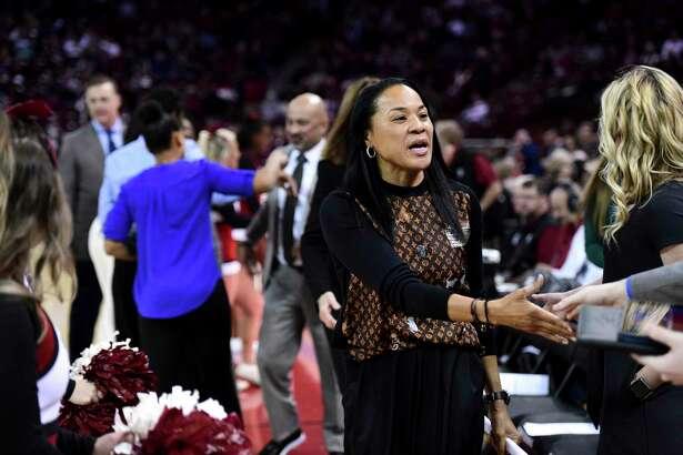 South Carolina coach Dawn Staley greets the Kentucky coaching staff before an NCAA college basketball game Thursday, Jan. 2, 2019, in Columbia, S.C. South Carolina defeated Kentucky 99-72. (AP Photo/Sean Rayford)