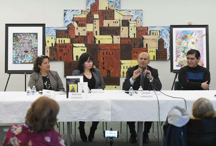 "Authors Mayole González, second from left, and Vicente Chinchilla, third from left, speaks about their new books beside moderators Ana Gallegos, left, and Fabián Cortés during the book launch event at the Government Center in Stamford, Conn. Sunday, Jan. 12, 2020. The event was put on by the Parent Leadership Training Institute, People Empowering People, and the Ecuadorian Civic Committee of Fairfield County to celebrate the launch of Mayole González' book ""Un Ángel en la Tierra"" (""An Angel on Earth"") and Vicente Chinchilla's book ""Guantes de Seda"" (""Gloves of Silk""). Photo: Tyler Sizemore / Hearst Connecticut Media / Greenwich Time"