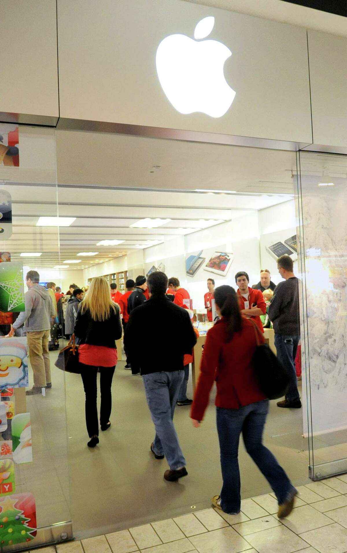 Shoppers enter a crowded Apple Store at Stamford Town Center in Stamford on Dec. 24, 2011. Apple has posted a message on the Stamford store's website that indicates the store is closing and will be replaced by Apple's new store at SoNo Collection mall in Norwalk, Conn.