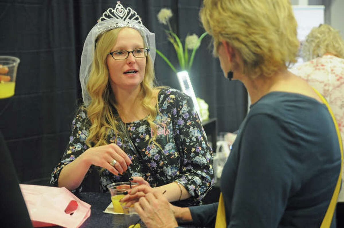 Elaine Duich of Godfrey wore wedding headgear and enjoyed the Mimosa bar during Sunday's Bridal Show at Lewis and Clark Community College Commons in Godfrey. Hundreds turned out for the event hosted by The Telegraph, The Intelligencer and On The Edge of the Weekend.