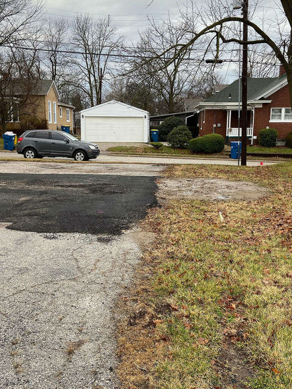 While currently patched for parking lot access, this sinkhole on the Crane Street side of Edwardsville Township's property reportedly has a buried furnace or boiler from a church that once stood on this site.